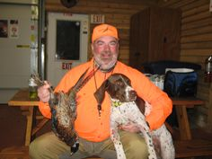 Polly with the bird I shot off her great point in Bruce, SD - Oct 2013