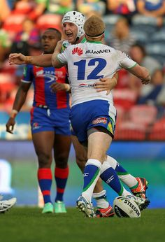2014 Round 2 Canberra Raiders V Newcastle Knights: Jarrod Croker of the Raiders celebrates a try with team mate Joel Edwards during the round two NRL match between the Newcastle Knights and t...