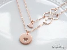 Set of 2 -18k Rose gold vermeil Mother Daughter Heart Set. An adorable gift for a mother and daughter. This set includes the large pendant with heart cut out, as well as the small dangle heart charm that fits right in place. A cute way to wear and remember the love for your little (or big) one always. Great for moms, and also you can add an initial charm to make an even more personalized gift! Pair with Rose gold filled chains. ★·18k Rose gold Vermeil Large Heart : 18mm ★·18k Rose gold…