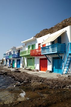 Brightly painted syrmata, in the village of Klima, on Milos island, Greece