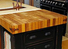 Tip-out waste bin with butcher block top
