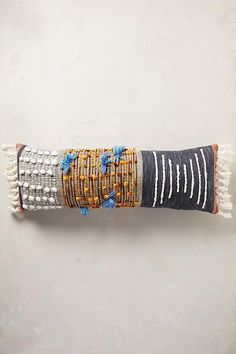 "All Roads Studio via anthropologie | Collaged Majida Pillow (14"" x 40"" lumbar multi pillow, $98)."