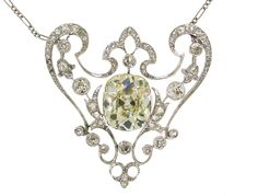 Stunning and versatile one-of-a-kind piece of jewelry - a necklace (two variations), a brooch (four variations) and a head-piece! It was created in France in the 1910's. The piece was made of platinum and set with a 6.29 cts cushion cut diamond in the center, Old European cut and rose cut diamonds. [Click to source to see variations. Quite frankly, I've already done too many splices before I've had my coffee]