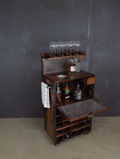 Custom Industrial Bar Cart #15 made of pine, steel and black pipe with casters in a red oak finish  Bare Knuckle Workshop Chicago