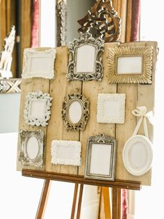 Rustic Wooden Table Plan with Ornate Frames - Image by Belle and Beau Photography - An Ian Stuart 'Sapphire' bridal gown for a classically romantic wedding at Rudding Park in Harrogate with a Dahlia bouquet and peach bridesmaid dresses www.rockmywedding.co.uk