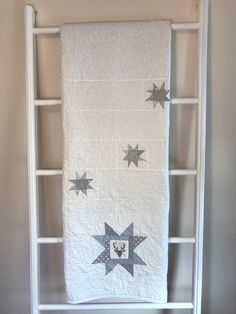 A personal favorite from my Etsy shop https://www.etsy.com/ca/listing/501955154/white-buck-with-grey-minky-quilt-white