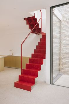 Designer Remi Connolly-Taylor, who is the founder of London studio Remi CT, has designed Maryland House in London, which features a glass brick enclosed staircase, as her own home and studio.