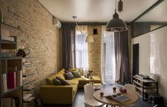 yellow sofa with tan walls | With Brick Wall Design And Brown Curtain With Yellow L Shaped Sofa ...