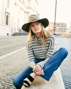 When it comes to looking effortlessly cool, nothing quite completes the wardrobe like a backdrop as stunning as Rome. Constance Jablonski poses there for Madewell's fall campaign, wearing striped sweaters, overalls, and plenty of dark denim. See all the stunning images.