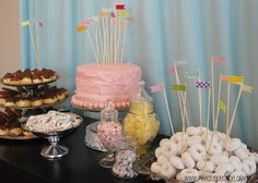 """Cute birthday party. Love the flags, love the cake (3 layers), love the icing and little """"balls"""" around the bottom..."""