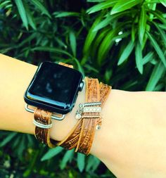 Please read full description and see photos prior to purchasing. Apple watch leather accessory band fits 38mm and 42 mm watch. Accessory band comes with adapters. The wrap bracelet style band is adjustable and available in Camel brown and black leather featuring a stamped vine design. Its subtle, elegant and casual all at the same time. This listing is for the Camel brown band.  Customize your band with charms that slide on! Select the charms shown or contact me to see more charm options. Be…