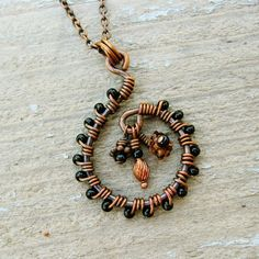 Antiqued Copper Wire Wrapped Swirl Necklace with black beads and dangles - cool