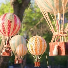 """""""Decorate your next outdoor soirée by hanging cute hot air balloons! They're so eye catching and add a little sass to the empty space above!"""""""
