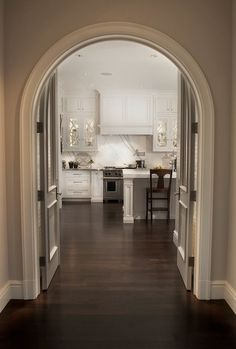 Caden Design Group: Gorgeous kitchen with floor to ceiling white kitchen cabinets with gray quartz ...