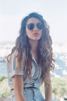 The natural hair look is very trendy right now! Get out of the shower, put alittle bit of frizz-restraint cream in your hair, preferably Minardi Subdue, and then just let it hair dry! And there you have a great, effortless do!