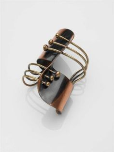 Modern Cuff Bracelet / Art Smith / c. 1948 / made of a single cut and bent piece of copper, pierced and attached to brass wires, each terminating in brass sphere / MFA, Boston