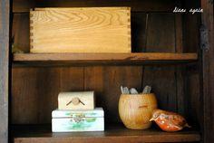 living room. black walnut cupboard shelf.  oak and maple boxes.
