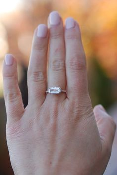 Baguette engagement ring. 1.09ct rectangular emerald cut white sapphire 14k rose…