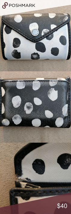 Marc by marc Jacobs wallet I used to love this wallet, it is worn down and has a blue tint on the front, I believe from my purse. The back is supposed to be faded. The inside is clean with 3 slots for cards. The 3rd picture is the inside corners,both are like that. The price is low due to the condition of wallet. Feel free to make an offer, or ask any questions. Marc by Marc Jacobs Bags Wallets