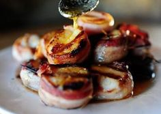 Baked Scallops and Bacon: 2 pounds Large Scallops 1/2 pound Bacon, Cut Into Thirds Or Halves 1 stick Butter Salt & pepper to taste Preparation Instructions:  Wrap bacon pieces around the outside of the scallops, then attach with a wooden skewer. Cook in a 425 oven (on a drip pan) for 20 minutes, or until bacon is sizzling and brown. Melt butter. Drizzle over scallops before serving.
