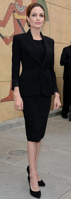A must have: classic black suit.   | Rita and Phill specializes in custom skirts.  Follow Rita and Phill for more tips on the written rules of office fashion!  https://www.pinterest.com/ritaandphill/conservative-office-outfits/