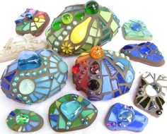 mosaic rocks - cool garden craft idea, tucked in here and there would add interest....