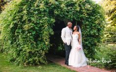 Magnolia Gardens Wedding | Springdale Arkansas | Bride and Groom portrait poses | Foliage covered Arch