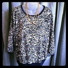 Jennifer Lopez blouse. Jennifer Lopez animal print blouse. Colors are navy blue, cream, brown and lavender. 3/4 length sleeves. Great condition.  Size XL Jennifer Lopez Tops Blouses