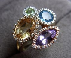 expensive coctail 14k golden ring with multicolor gemstones (topaz, amethyst, peridot, citrine) and diamonds