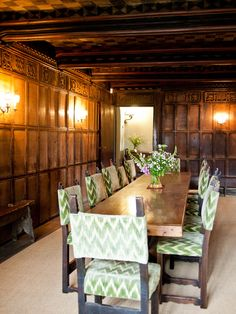 Haddon Hall dining room with antique flame-stitch upholstery on the chairs