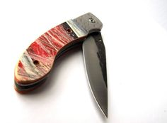 A one-of-a-kind pocketknife made from an upcycled skateboard deck.