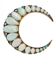 An Antique Opal and Diamond Crescent Brooch. The crescent design decorated with a graduated course of round, oval and pear-shaped opals accented with small rose-cut diamonds, mounted in 18k gold, late 19th century