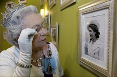 Royal exhibition: A look-a-like of Her Majesty views the collection of photos that go on display in Debenhams from today