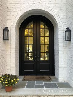 Custom iron front entry doors transform the design of any entrance. With large glass windows to let in all the natural light, these custom made traditional double doors take your exterior french door ideas to the next level. Arched Front Door, Double Front Entry Doors, Iron Front Door, Front Doors With Windows, Arched Doors, Iron Doors, Double Doors Exterior, Front Entrances, Home Front Door