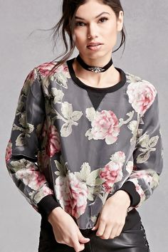 A sheer mesh sweatshirt featuring an allover floral print, knit underlayer, ribbed trim, long sleeves, and a round neckline. This is an independent brand and not a Forever 21 branded item.