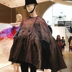 Here's another glamour shot from the Balenciaga exhibit at the @vamuseum. I love this cape so much; I want it in every fabric. I'm also quite hearts for eyes about the reinterpretation Ghesquiere did when he helmed the label a few years back (swipe right to see it). The shape is simple, but perfectly executed. #balenciaga