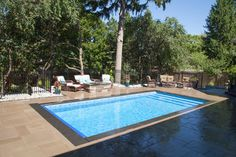 A beautiful Rectangle Inground Pool from Pioneer Family Pools that features Vinyl over Steel steps and an Automatic Cover. View the Pool Showcase here. Pool Steps Inground, Swimming Pools Backyard, Rectangle Pool, Family Pool, Pool Coping, Vinyl Cover, Backyard Patio, Outdoor Decor, Spa