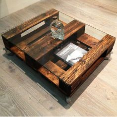 Bespoke Edition - Built to last crate coffee table in updated antique finish. Strong and sturdy on castors and the top is a Reclaimed Pallet with 10mm glass