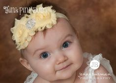 This beautiful headband features two frayed shabby chic flowers on an elastic headband. It is topped with a luxurious and eye catching rhinestone. The flowers are felt backed for comfort. Simple and yet elegant, sure to be a real head turner!! Pair it with one of our adorable lace petti rompers for a complete look. The perfect headband for summer pictures, a summer picnic, a playdate, or an outing with mama!