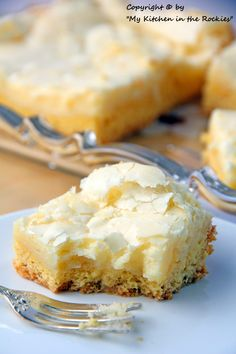 Cyndee's Neiman Marcus Cake: A vanilla cake bottom and a sweet, crunchy creamy cheese topping.  It can be made with boxed cake mix too!