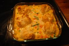 Chicken and Biscuits casserole 6 points plus  1 can (10 3/4 ounce) Campbell's 98% Fat Free Cream of Chicken Soup 3/4 cup fat free sour cream, divided 2 cups cooked chopped chicken (cooked it on medium in the microwave, can also season with garlic power and black pepper and grill on the George Foreman) 1 pkg (16 ounce) frozen mixed vegetables 1 cup reduced fat shredded cheddar cheese 1 cup Bisquick Heart Smart baking mix 3 Tbsp skim milk