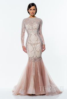 Lace trumpet gown featuring sheer lace sleeves and intricate beadwork along the bodice. Dress is finished with a flared mesh skirt