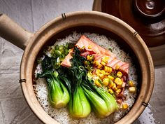 This Ginger Crispy Rice with Salmon and Bok Choy recipe gets its flavor from jasmine rice, salmon belly, and toasted sesame oil. Get the recipe from Food & Wine. Salmon Recipes, Fish Recipes, Asian Recipes, Ethnic Recipes, Veggie Recipes, Seafood Recipes, Salmon And Bok Choy, Bok Choy Recipes, Thing 1