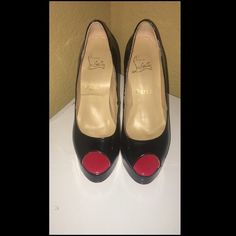 Black Patent Peep Toe Red Bottom Heels Gorgeous super high red bottom heels. I purchased them at a thrift store but are inspired CL hence the price. Patent Peep Toe Black Heels. They have some scuffs on the heel, but in good condition. Offers welcome. Can sell on MERC for less. I can upload more pictures. Christian Louboutin Shoes Heels