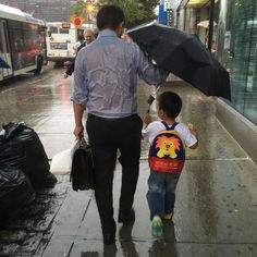 How The 'Umbrella Dad' Is Using His Viral Fame For Good