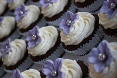 """Lilac hydrangea wedding cupcakes: chocolate cupcakes with white chocolate buttercream, topped w/lilac sugar hydrangeas."""