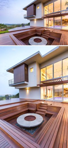 Building A Deck 550705860683859268 - This modern house has a large wood deck that's home to a sunken wood firepit with built-in benches, ideal for outdoor entertaining and star gazing.