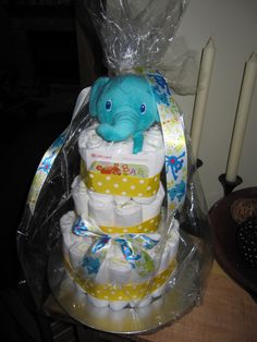 Simple and small diaper cake - 1 package size 1 diapers, small rubber bands, 2 types of ribbon, baby powder in the middle, cheap charger from Michaels, cellophane bag from Michaels, elephant toy from Walmart