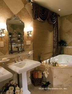 With a Lutron dimmer you can brighten lights for   applying makeup or dim them for relaxing in  the tub.  www.automation-design.com