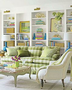I love this room, esp. the very large bookcase, and the crisp green gingham on the couch.